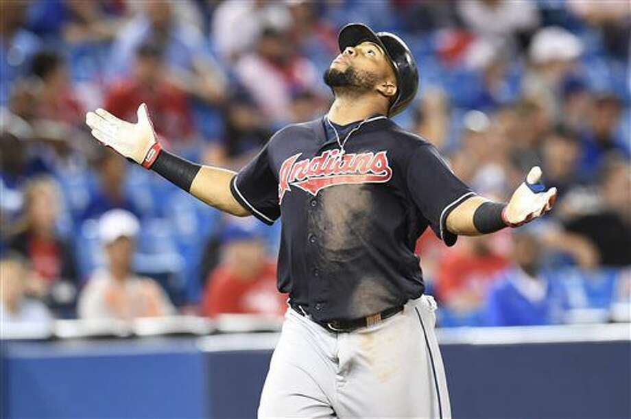 Cleveland Indians' Carlos Santana celebrates his home run against the Toronto Blue Jays during the 19th inning of a baseball game in Toronto on Friday, July 1, 2016. The Indians won 2-1 in 19 innings. (Frank Gunn/The Canadian Press via AP) Photo: Frank Gunn