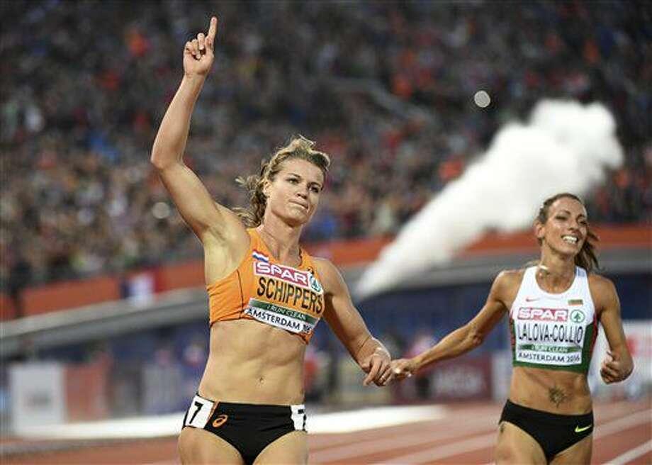 Netherlands' Dafne Schippers celebrates after winning the women's 100m final during the European Athletics Championships in Amsterdam, the Netherlands, Friday, July 8, 2016. (AP Photo/Geert Vanden Wijngaert) Photo: Geert Vanden Wijngaert