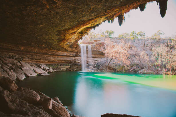 TEXAS: HAMILTON POOL PRESERVE Just a short drive away from Austin, Texas, you'll find the magical (and historic) Hamilton Pool Preserve. Hamilton Creek spills out over a limestone overhang to create a 50-foot waterfall and underlying pool, which is a popular swimming spot. It's so popular, in fact, that Travis County Parks has started taking visitor reservations for it.