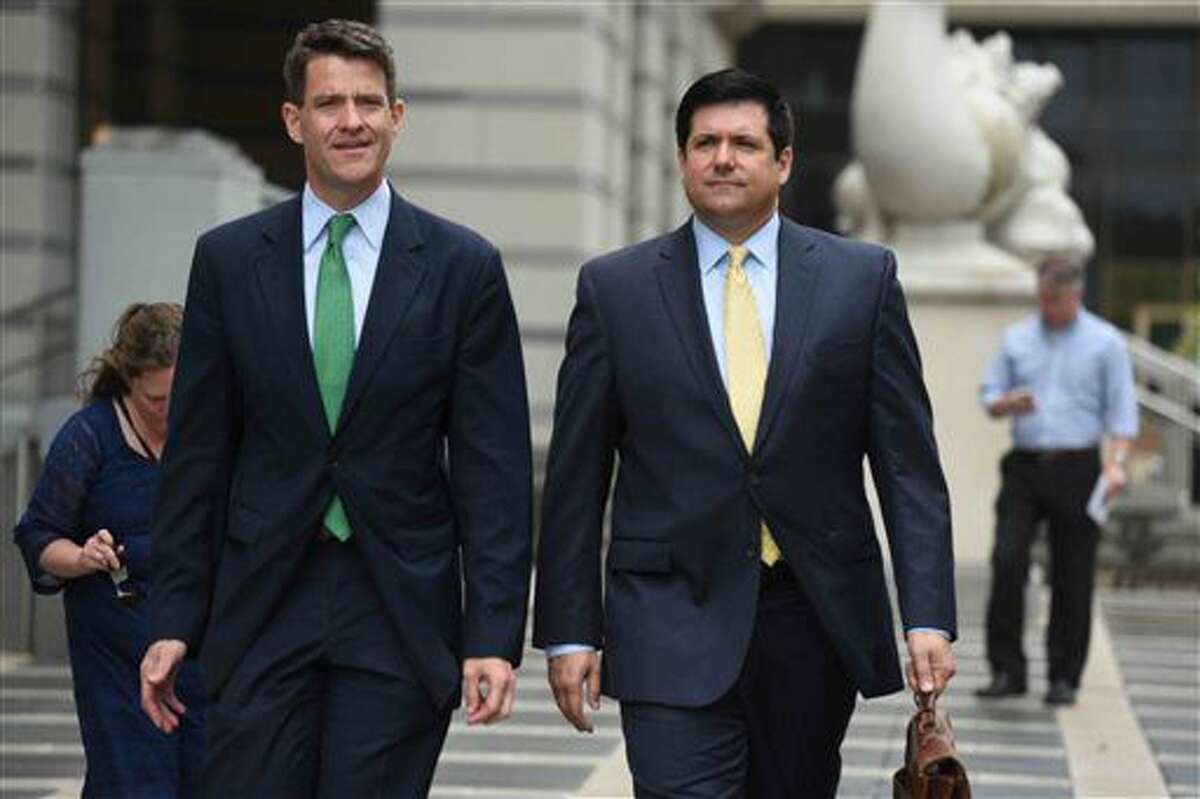 Bill Baroni, left, and his attorney, Michael Baldassare, leave U.S. District Court in Newark, N.J. on Thursday, July 7, 2016. U.S. District Judge Susan Wigenton granted a motion by the law firm representing Christie's office to quash a subpoena by Bill Baroni and Bridget Kelly, who face trial in the fall on charges they conspired to close lanes to create traffic jams in 2013 to punish a Democratic mayor for not endorsing Christie. (Amy Newman/The Record of Bergen County via AP)