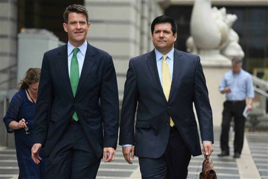 Bill Baroni, left, and his attorney, Michael Baldassare, leave U.S. District Court in Newark, N.J. on Thursday, July 7, 2016. U.S. District Judge Susan Wigenton granted a motion by the law firm representing Christie's office to quash a subpoena by Bill Baroni and Bridget Kelly, who face trial in the fall on charges they conspired to close lanes to create traffic jams in 2013 to punish a Democratic mayor for not endorsing Christie. (Amy Newman/The Record of Bergen County via AP) Photo: Amy Newman