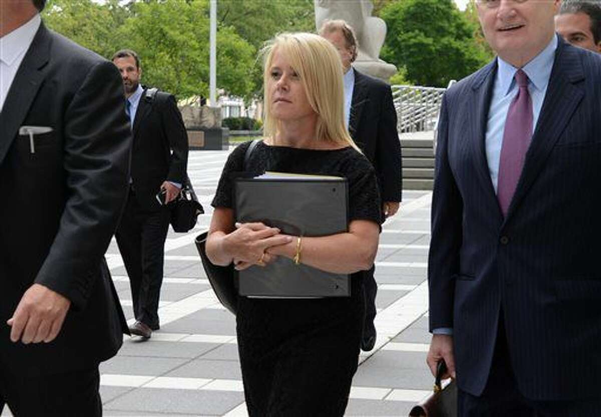 Bridget Anne Kelly and her attorney, Michael Critchley Sr., right, leave U.S. District Court in Newark, N.J. on Thursday, July 7, 2016. U.S. District Judge Susan Wigenton granted a motion by the law firm representing Christie's office to quash a subpoena by Bill Baroni and Bridget Kelly, who face trial in the fall on charges they conspired to close lanes to create traffic jams in 2013 to punish a Democratic mayor for not endorsing Christie. (Amy Newman/The Record of Bergen County via AP)