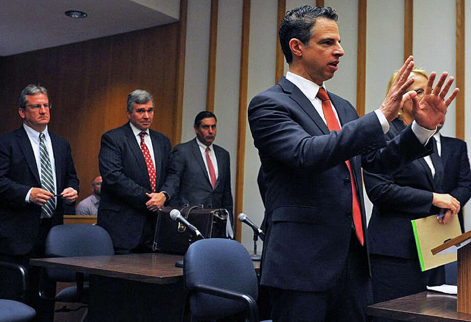 Attorney Joshua Koskoff, right, who represents a group of Sandy Hook families, speaks during a June hearing in Superior Court in Bridgeport Photo: Ned Gerard / The Connecticut Post Via AP, Pool