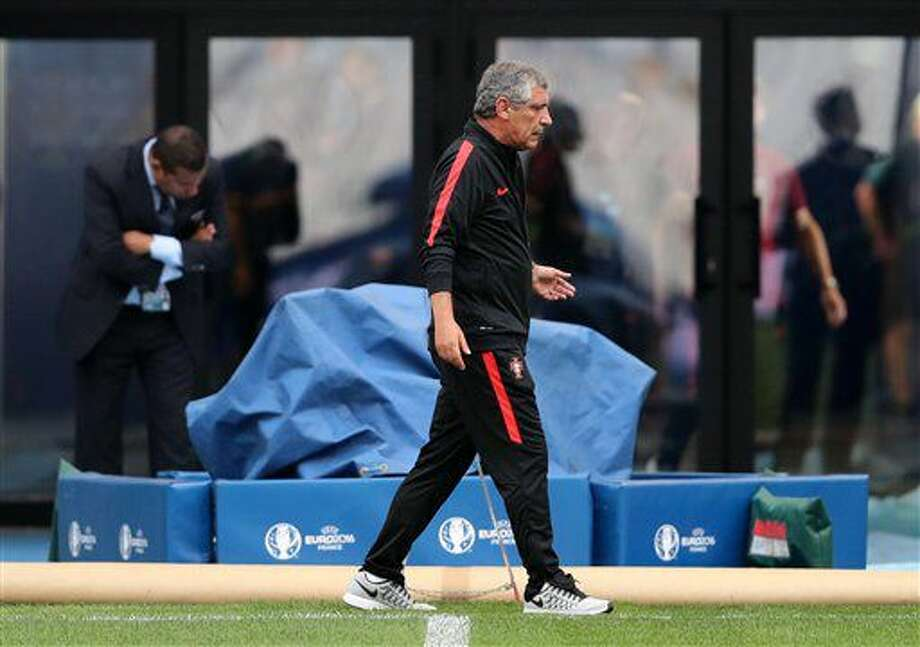Portugal coach Fernando Santos inspects the pitch of the Velodrome stadium in Marseille, France, Wednesday, June 29, 2016. Portugal will face Poland in a Euro 2016 quarter final soccer match in Marseille on Thursday. (AP Photo/Thanassis Stavrakis) Photo: Thanassis Stavrakis