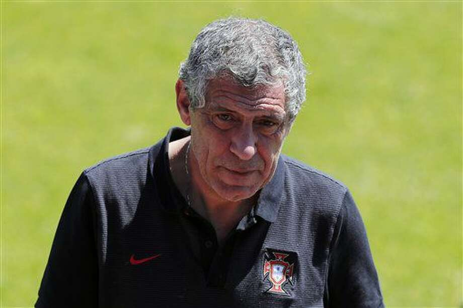 Portugal coach Fernando Santos walks on the pitch during a training session on the day after the Euro 2016 semifinal soccer match between Portugal and Wales, in Marcoussis, south of Paris, Thursday, July 7, 2016. (AP Photo/Francois Mori) Photo: Francois Mori