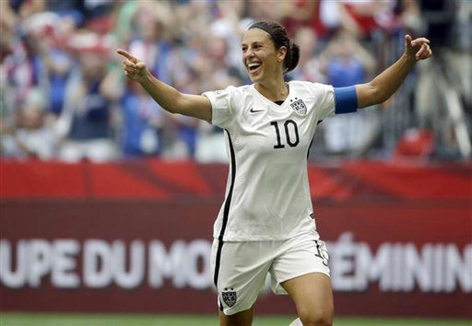 FILE - In this July 5, 2015, file photo, Carli Lloyd of the U.S celebrates scoring her third goal against Japan during the first half of the FIFA Women's World Cup soccer championship in Vancouver, British Columbia, Canada. Carli Lloyd says the time she's had to take to recover from a minor knee injury has been a blessing. It helped her slow down and reflect on a wild year. (AP Photo/Elaine Thompson, File) Photo: Elaine Thompson