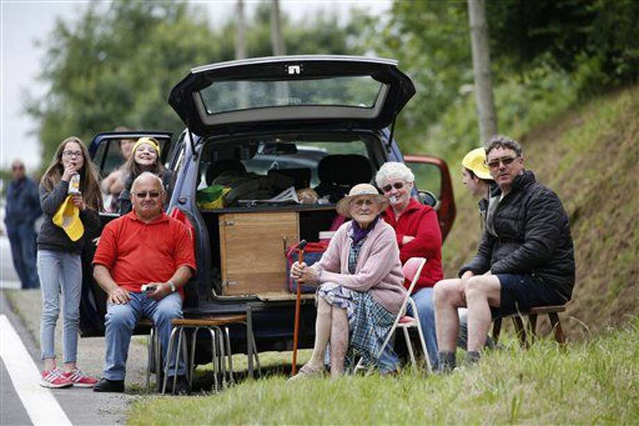 Spectators wait for the pack to pass during the third stage of the Tour de France cycling race over 223.5 kilometers (138.6 miles) with start in Granville and finish in Angers, France, Monday, July 4, 2016. (AP Photo/Christophe Ena) Photo: Christophe Ena