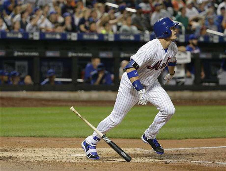 El jugador de los Mets de Nueva York Brandon Nimmo corre por la línea de primera base tras batear un jonrón de tres carreras contra lo Cachorros de Chicago durante el cuarto inning de su juego de béisbol, el viernes 1 de julio de 2016 en Nueva York. (AP Foto/Julie Jacobson) Photo: Julie Jacobson