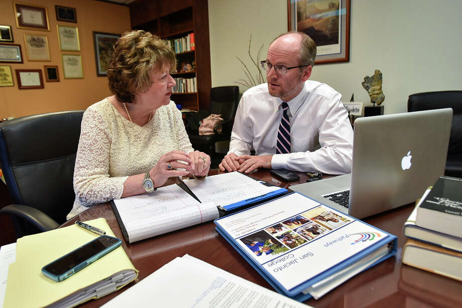 Laurel Williamson, San Jacinto College deputy chancellor and president, discusses the new open educational resources degree program with Mark Johnson, North Campus English and modern languages department chair.