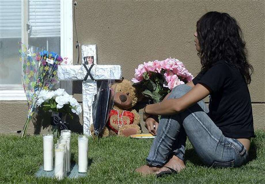 Friends and family mourn at a memorial for sixteen-year-old Jose Izazaga and his 15-year-old sister Abril Izazaga, Thursday, July 7, 2016 in Midvale, Utah. As police search for a man who police say gunned down a teenage brother and sister during an argument over a T-shirt late Wednesday at a Salt Lake City suburb apartment complex, family members are mourning the senseless killing of siblings who shared a tight bond. (Al Hartmann/The Salt Lake Tribune via AP) Photo: Al Hartmann