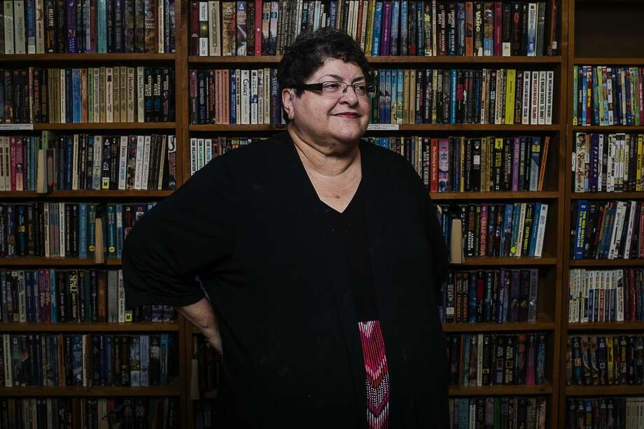 ERIN KIRKLAND | ekirkland@mdn.net Sleepy Hollow Bookshop owner Joi Henton poses for a portrait at her store on Friday. The store, which has been open since 1996 and owned by Henton since 2008, will be closing. Photo: Erin Kirkland
