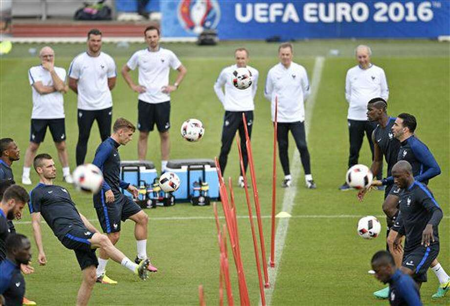 France's Antoine Griezmann, left, exercises with France's Paul Pogba, right, during a training session of the French national team in Clairefontaine training center, outside Paris, France, Wednesday, June 29, 2016. France will face Iceland in a Euro 2016 quarter final soccer match in Saint-Denis on Sunday, July 3, 2016. (AP Photo/Martin Meissner) Photo: Martin Meissner