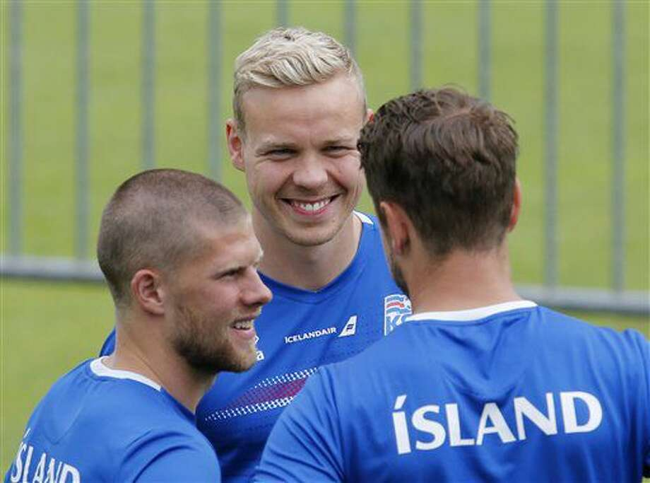 Johann Berg Gudmundsson, Kolbeinn Sigthorsson and Kari Arnason, from left, attend a training session of Iceland's national soccer team at their base camp in Annecy, France, Thursday, June 30, 2016. Iceland will face France in a Euro 2016 quarterfinal match in Paris on Sunday, July 3, 2016.(AP Photo/Michael Probst) Photo: Michael Probst