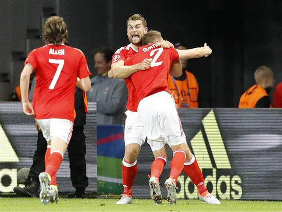 Wales' Sam Vokes, center, celebrates after scoring his side's third goal during the Euro 2016 quarterfinal soccer match between Wales and Belgium, at the Pierre Mauroy stadium in Villeneuve d'Ascq, near Lille, France, Friday, July 1, 2016. (AP Photo/Frank Augstein) Photo: Frank Augstein