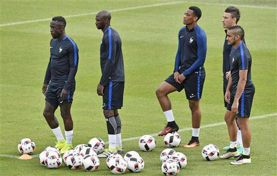 France's Dimitri Payet, Laurent Koscielny, Anthony Martial, Eliaquim Mangala and Bacary Sagna, from right, wait for new exercises during a training session of the French national team in Clairefontaine training center, outside Paris, France, Wednesday, June 29, 2016. France will face Iceland in a Euro 2016 quarter final soccer match in Saint-Denis on Sunday, July 3, 2016. (AP Photo/Martin Meissner) Photo: Martin Meissner