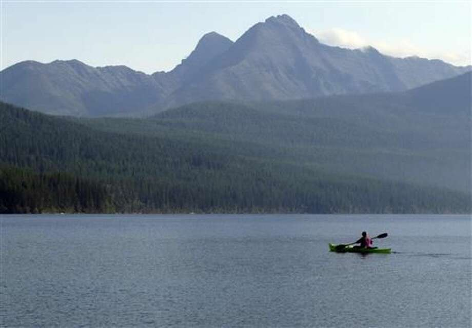In this Sept. 6, 2013, file photo, a woman kayaks on Kintla Lake in Glacier National Park, Mont. A grizzly bear attacked and killed a 38-year-old mountain biker Wednesday, June 29, 2016, as he was riding along a trail just outside the national park, Montana authorities said. Photo: AP Photo | Matt Volz, File