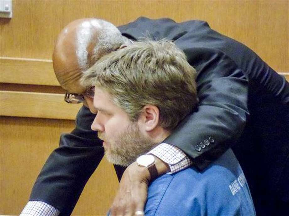 Matthew Skalitzky, seated , talks to his lawyer, Stanley Woodard, before a hearing, Wednesday June 29, 2016, in Dane County Court in Madison, Wis. Skalitzky, who who killed his mother with a sword last year, pleaded guilty Wednesday to first-degree intentional homicide, then was committed to a state mental hospital after prosecutors and defense lawyers in the case agreed that he was mentally ill at the time of the killing. (Ed Trevelen/Wisconsin State Journal via AP) Photo: Ed Trevelen
