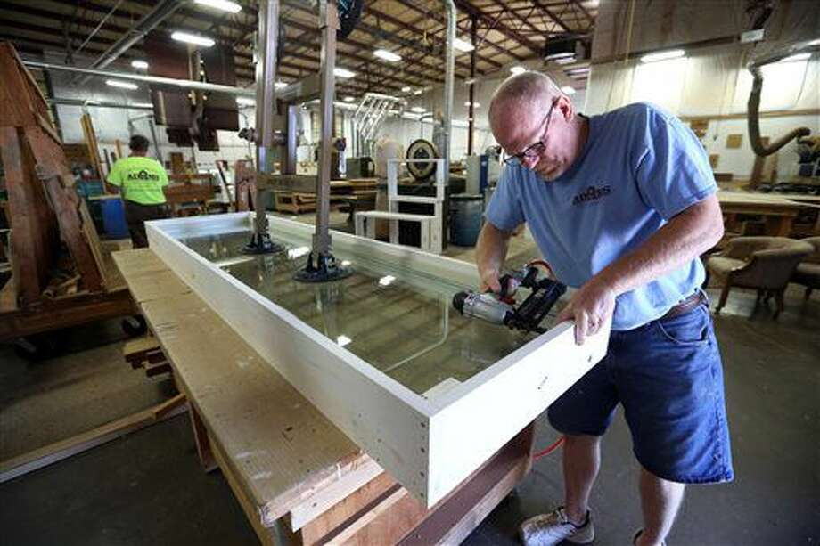FOR RELEASE SATURDAY, JULY 2, 2016, AT 12:01 A.M. CDT. - Jim Lauer works on a window Tuesday, June 21, 2016, at Dubuque Window and Door/Adams Architectural Millwork in Dubuque, Iowa. (Jessica Reilly/Telegraph Herald via AP) Photo: Jessica Reilly