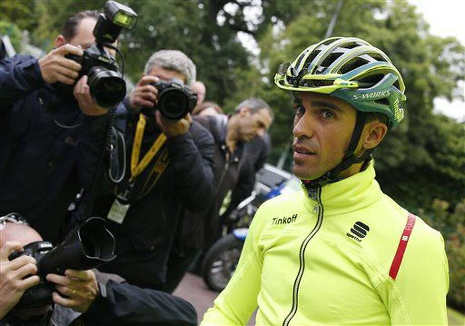 Photographers take pictures of Spain's Alberto Contador as he prepares to leave for a training ahead of Saturday's start of the Tour de France cycling race, near Coutances, France, Friday, July 1, 2016. (AP Photo/Christophe Ena) Photo: Christophe Ena
