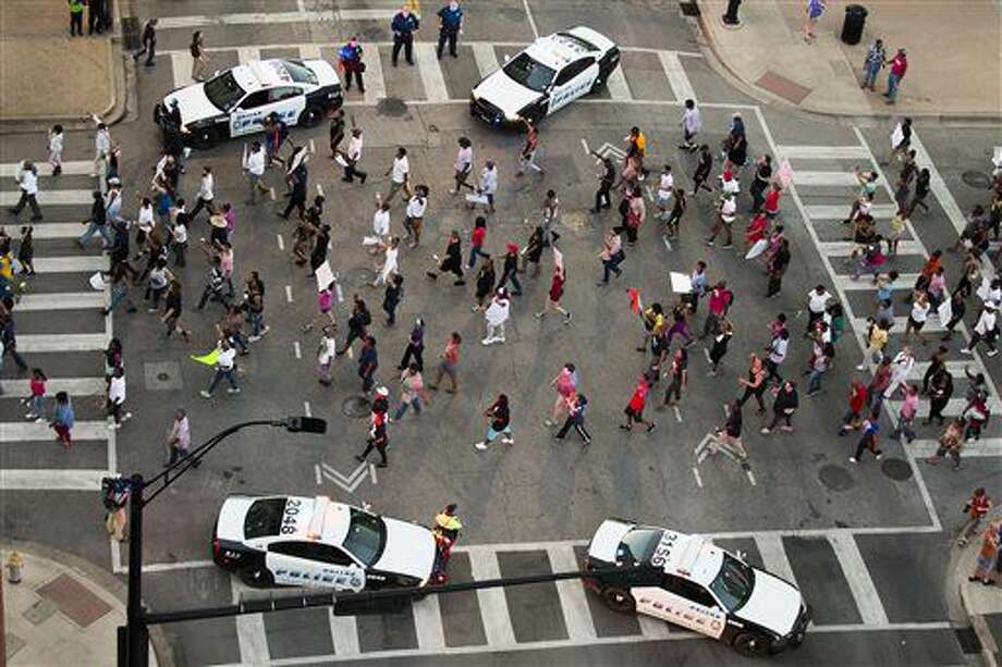 Protesters march during a Black Live Matter rally in downtown Dallas on Thursday, July 7, 2016. Multiple media outlets report that shots were fired later Thursday during the protest over two recent fatal police shootings of black men. (Smiley N. Pool/The Dallas Morning News via AP) Photo: Smiley N. Pool