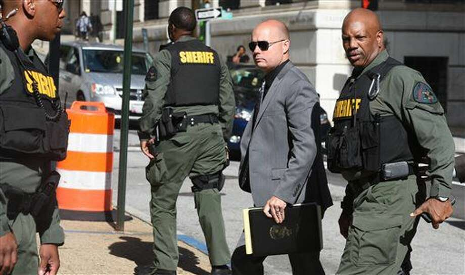 Baltimore Police Lt. Brian Rice, center, arrives at Courthouse East Tuesday, July 5, 2016 in Baltimore for a pretrial hearing related to the arrest and death of Freddie Gray. Rice's lawyers said Tuesday that he has chosen to be tried instead by a judge, the same one who acquitted two fellow officers in Freddie Gray's death. (Jerry Jackson/Baltimore Sun via AP) Photo: Jerry Jackson