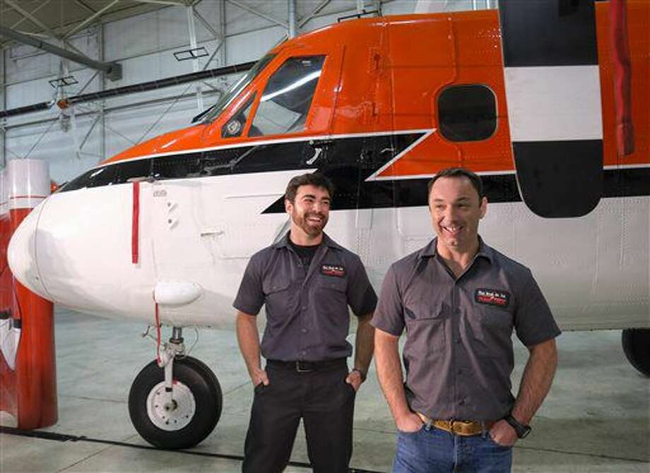 Kenn Borek Air pilots Wally Dobchuk, right, and Sebastien Trudel, pose with the Twin Otter airplane they used in a successful medical evacuation of two researchers from Antarctica, in Calgary, Alta., Tuesday, July 5, 2016. In an Associated Press interview Tuesday, Chief pilot Dobchuk and first officer Trudel said they weren't comfortable being called heroes. They were just doing their jobs. Dobchuk said his friend a police officer is a hero, while Dobchuk's wife had a harder job taking care of his daughter. National Science Foundation officials said the workers rescued in June from the isolated station are doing better, back home getting medical care. (Jeff McIntosh/The Canadian Press via AP) Photo: Jeff McIntosh