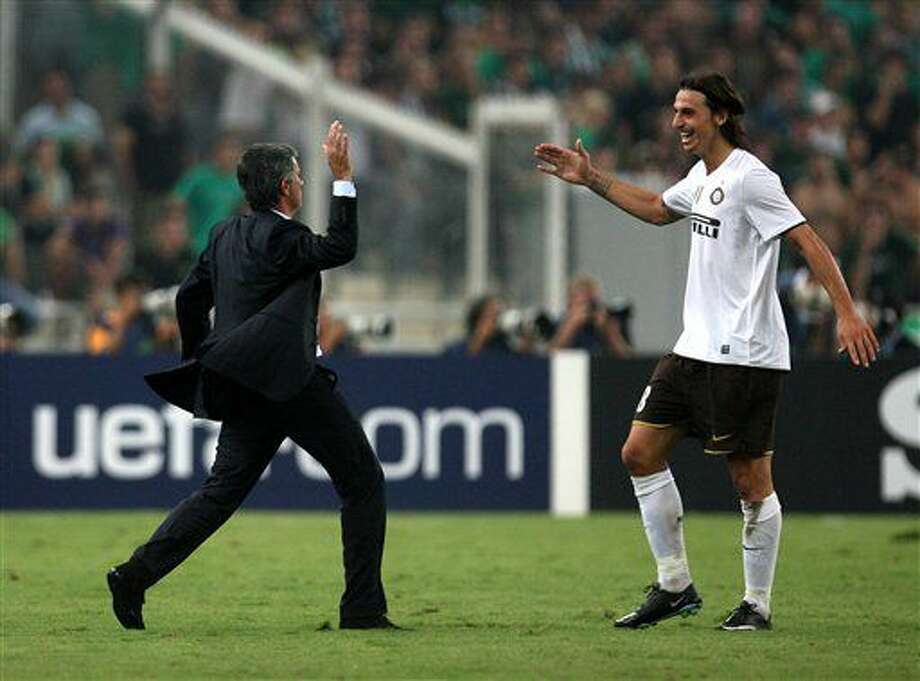FILE - In this Tuesday, Sept. 16, 2008 file photo, Inter Milan coach Jose Mourinho congratulates Zlatan Ibrahimovic, right, after scoring against Panathinaikos, during a Champions League soccer match at the Olympic stadium of Athens. Zlatan Ibrahimovic said on his official social media accounts Wednesday, June 30, 2016 that his next club will be Manchester United. (AP Photo/Thanassis Stavrakis, File) Photo: Thanassis Stavrakis