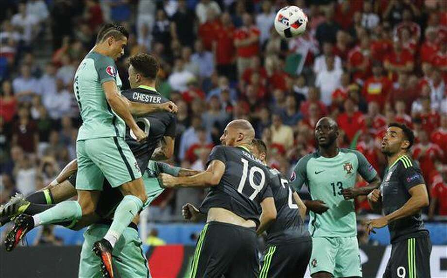 Portugal's Cristiano Ronaldo scores on a header during the Euro 2016 semifinal soccer match between Portugal and Wales, at the Grand Stade in Decines-Charpieu, near Lyon, France, Wednesday, July 6, 2016. (AP Photo/Frank Augstein) Photo: Frank Augstein