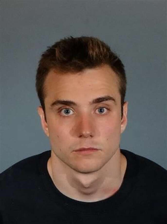 This Wednesday photo released by Los Angeles County Sheriff's Department shows Calum McSwiggan. The London-native gay YouTube personality who said he was assaulted outside a West Hollywood club has been charged with filing a false police report and faking his injuries. Photo: Los Angeles County Sheriff's Department Via AP