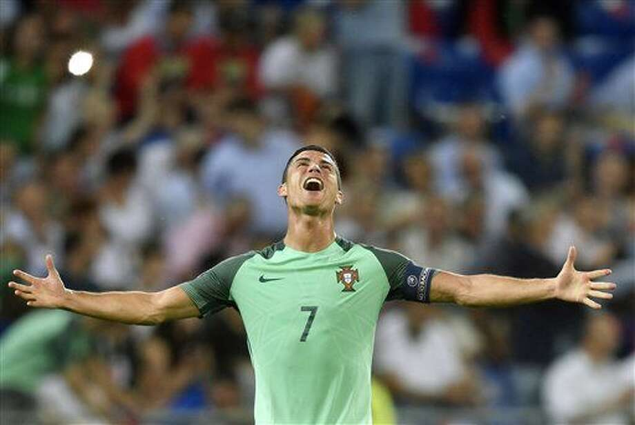 Portugal's Cristiano Ronaldo celebrates at the end of the Euro 2016 semifinal soccer match between Portugal and Wales, at the Grand Stade in Decines-­Charpieu, near Lyon, France, Wednesday, July 6, 2016. Portugal won 2-0. (AP Photo/Martin Meissner) Photo: Martin Meissner
