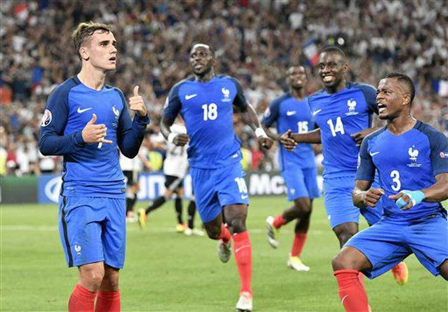 France's Antoine Griezmann, left, celebrates after scoring the opening goal during the Euro 2016 semifinal soccer match between Germany and France, at the Velodrome stadium in Marseille, France, Thursday, July 7, 2016. (AP Photo/Martin Meissner) Photo: Martin Meissner