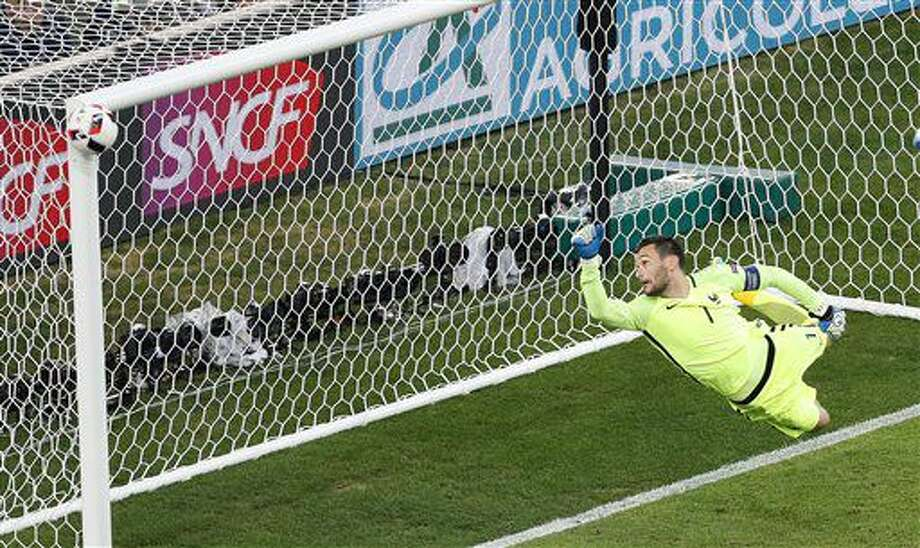France goalkeeper Hugo Lloris watches as a shot from Germany's Joshua Kimmich hits the post during the Euro 2016 semifinal soccer match between Germany and France, at the Velodrome stadium in Marseille, France, Thursday, July 7, 2016. (AP Photo/Michael Sohn) Photo: Michael Sohn