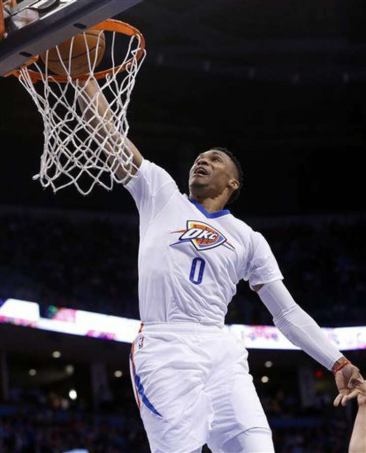 FILE - In this March 22, 2016, file photo, Oklahoma City Thunder guard Russell Westbrook (0) dunks during an NBA basketball game against the Houston Rockets in Oklahoma City. Westbrook is no longer sharing the NBA marquee in Oklahoma City after the Thunder lost much of their identity when free agent Kevin Durant chose to join the Golden State Warriors on Monday, July 4, 2016. (AP Photo/Sue Ogrocki, File) Photo: Sue Ogrocki