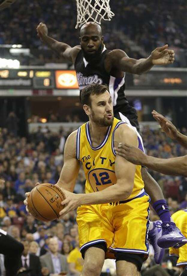 FILE- In this Jan. 9, 2016, file, photo, Golden State Warriors center Andrew Bogut, of Australia, looks to pass as Sacramento Kings forward Quincy Acy, background, defends during the first quarter of an NBA basketball game in Sacramento, Calif. A person with knowledge of the deal says the Dallas Mavericks have agreed to acquire center Bogut from Golden State, which is clearing salary cap room after winning the Kevin Durant sweepstakes. Other details of the trade are still being worked out, the person told The Associated Press on Monday, July 4, on condition of anonymity because the deal hasn't been finalized and can't be official until league business resumes Thursday. (AP Photo/Rich Pedroncelli, File) Photo: Rich Pedroncelli