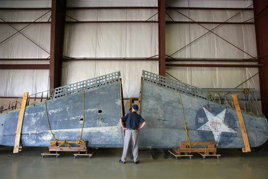 In a July 1, 2016 photo, a Douglas SBD-2P Dauntless WWII bomber is delivered to the Air Zoo East Campus for restoration in Portage, Mich. The WWII dive bomber marks the third Lake Michigan-recovered aircraft project granted to the Air Zoo, whose Restoration Center is considered one of the nation's top locations for military aircraft restoration work. (Mark Bugnaski/Kalamazoo Gazette-MLive.com via AP) Photo: Mark Bugnaski
