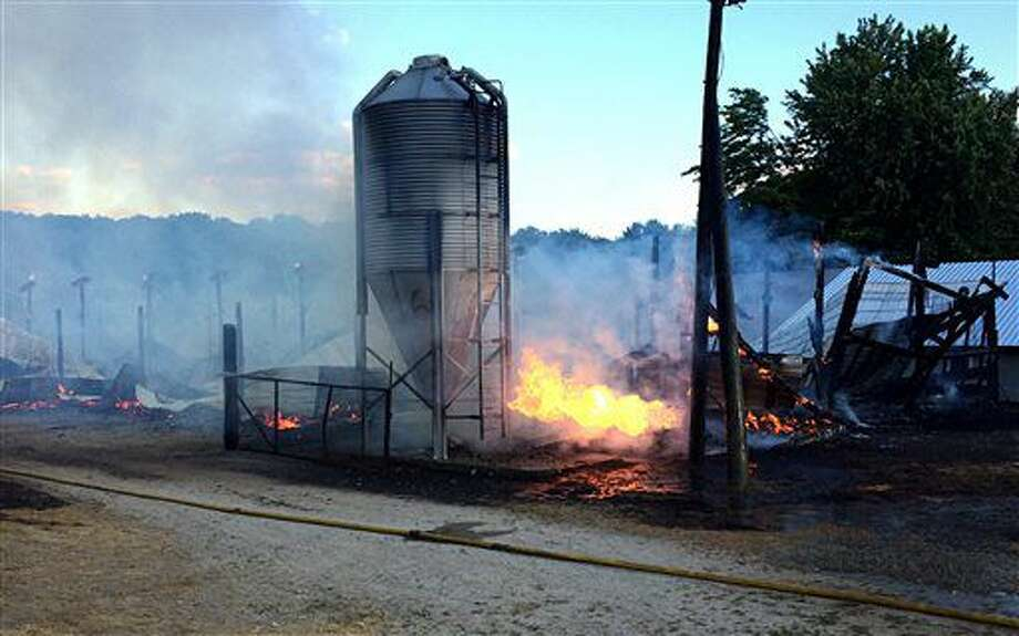 In this Thursday, June 30, 2016, a barn at Bob's Turkey Farm in Lancaster, Mass., burns to the ground. The Massachusetts family who owns the farm said thousands of baby turkeys perished in the fire. (Rick Cinclair /Worcester Telegram & Gazette via AP) Photo: Rick Cinclair
