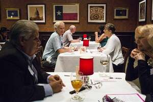In a June 22, 2016 photo, Phil Kellogg, 65, of San Antonio, glances over at Joyce Joyce Martinez during a senior speed dating event at Bob's Chop and Steakhouse in San Antonio. (Brittany Greeson/San Antonio Express-News via AP) MAGS OUT NO SALES SAN ANTONIO OUT
