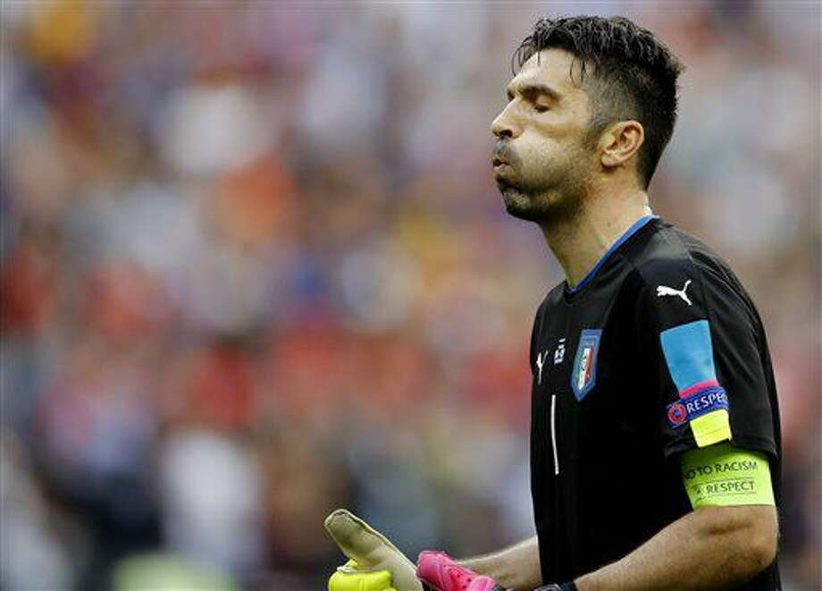 Italy goalkeeper Gianluigi Buffon reacts after Graziano Pelle' scored, during the Euro 2016 round of 16 soccer match between Italy and Spain, at the Stade de France, in Saint-Denis, north of Paris, Monday, June 27, 2016. (AP Photo/Frank Augstein) Photo: Frank Augstein