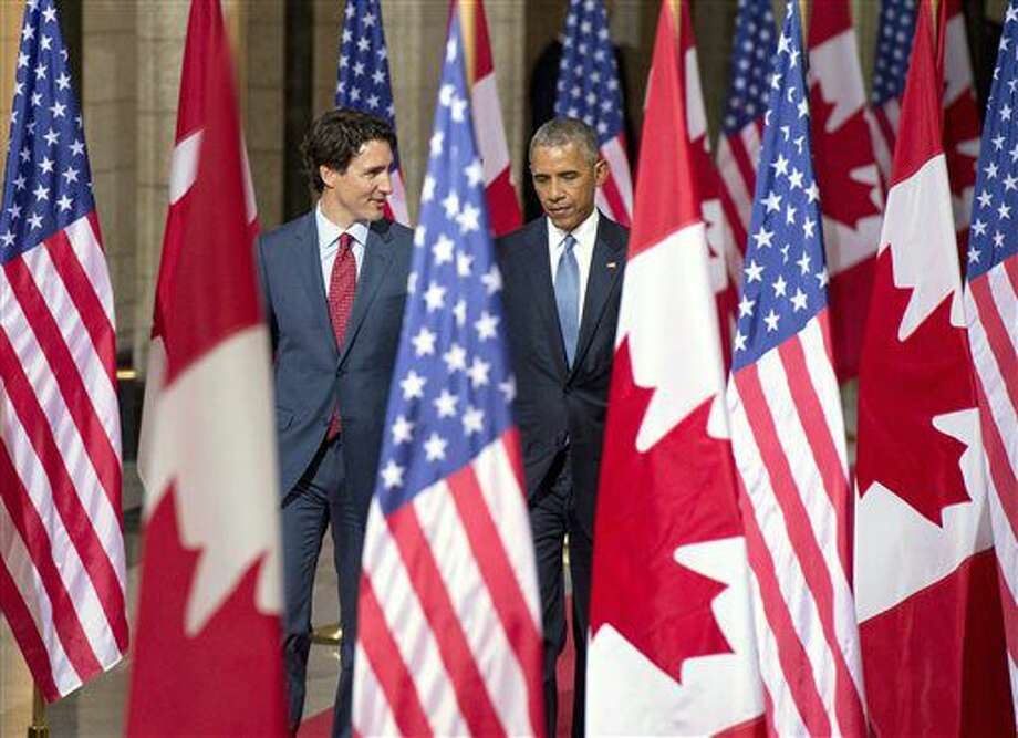 U.S. President Barack Obama, right, walks with Canadian Prime Minister Justin Trudeau as they leave Parliament Hill in Ottawa on Wednesday, June 29, 2016. (Justin Tang/The Canadian Press via AP) Photo: Justin Tang