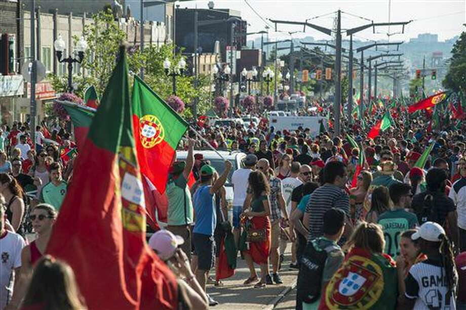 Fans take over St Clair West Avenue after Portugal's victory over France in the Euro final soccer match in Toronto,Sunday, July 10, 2016. (Eduardo Lima/The Canadian Press via AP) Photo: Eduardo Lima