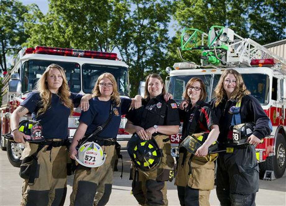 ADVANCE FOR SATURDAY JULY 9 AND THEREAFTER - In a June 14, 2016 photo, a group of west county volunteer firefighters poses for a picture, including, from left: Lindsay Weidler of Girard, rookie Lake City Fire Company firefighter and EMT; Jennifer Waxham of Lake City, deputy chief of EMS at Lake City Fire Company; Kim Hyde of Girard, EMS lieutenant at Girard's A. F. Dobler Hose & Ladder Company; Stephanie Fox of Waterford, a captain of Waterford's Stancliff Hose Company; and Emma Blasius of Millcreek Township, a firefighter and EMT at Millcreek Township's Kuhl Hose Company, at the Dobler fire station in Girard, Pa. (AP Photo/Erie Times-News, Andy Colwell) Photo: Andy Colwell
