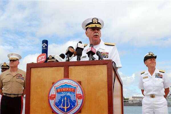 U.S. Pacific Fleet commander Adm. Scott Swift speaks at a news conference, Tuesday, July 5, 2016 in Pearl Harbor, Hawaii, at the start of the Rim of the Pacific military exercises. Swift says he wants all 26 nations participating in the drills to leave better prepared to respond to humanitarian crises and better understanding best practices for using maritime power. (AP Photo/Audrey McAvoy)