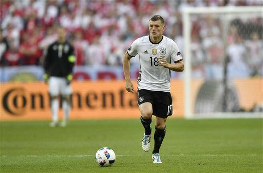 FILE - In this Thursday, June 16, 2016 file photo, Germany's Toni Kroos runs with the ball during the Euro 2016 Group C soccer match between Germany and Poland at the Stade de France in Saint-Denis, north of Paris. (AP Photo/Martin Meissner, File) Photo: Martin Meissner