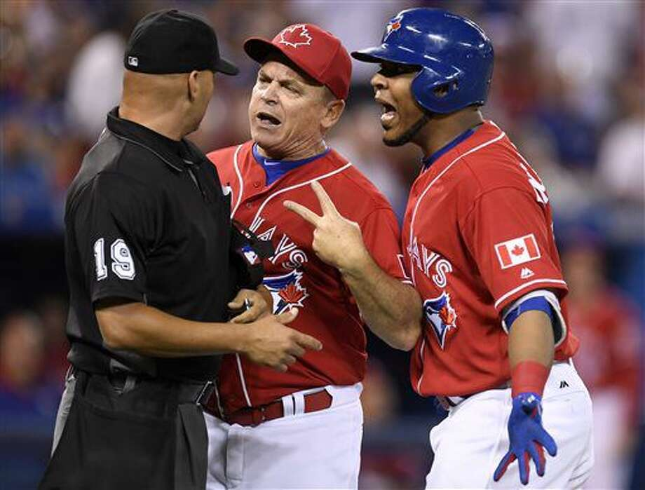Toronto Blue Jays manager John Gibbons, center, and designated hitter Edwin Encarnacion exchange words with umpire Vic Carapazza (19) after Encarnacion was ejected from the game over a call-out on strikes during the first inning of a baseball against the Cleveland Indians in Toronto., Friday, July 1, 2016. The confrontation resulted in Gibbons also getting ejected from the game. (Frank Gunn/The Canadian Press via AP) Photo: Frank Gunn