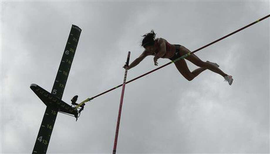 Jenn Suhr competes during the women's pole vault final at the U.S. Olympic Track and Field Trials, Sunday, July 10, 2016, in Eugene Ore. (AP Photo/Charlie Riedel) Photo: Charlie Riedel