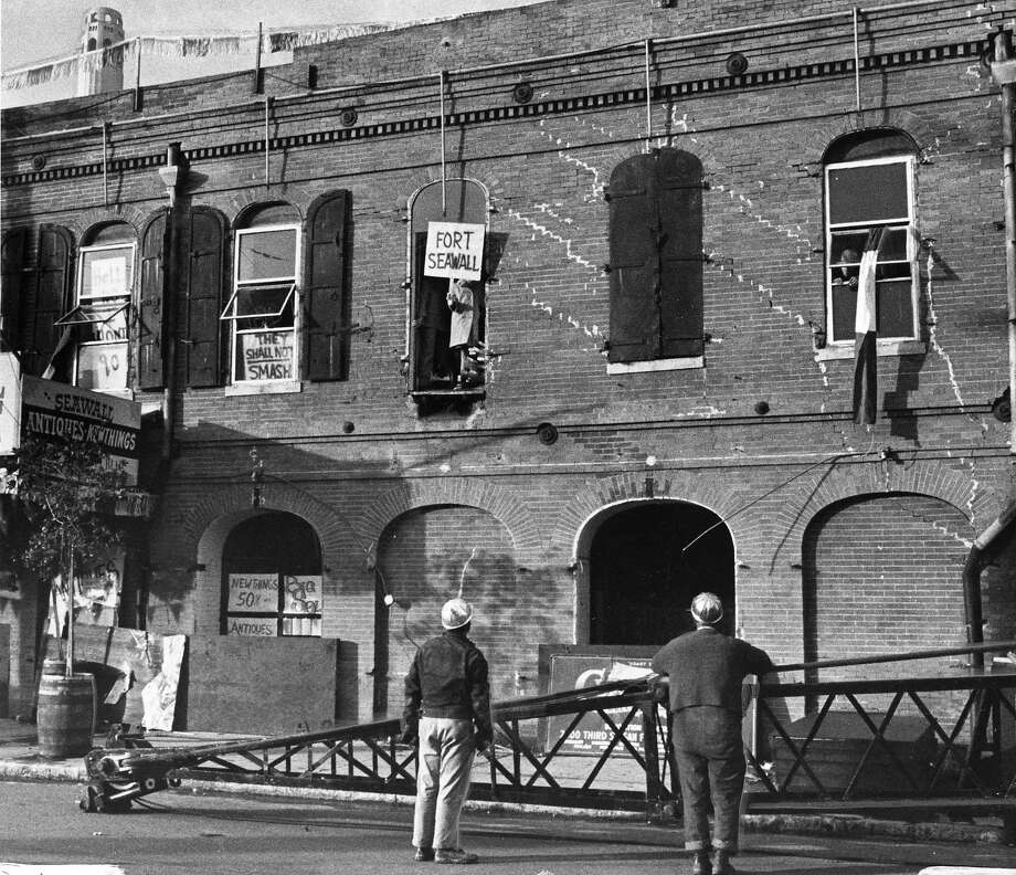 The SeaWall Warehouse, known as Fort SeaWall, was partially demolished when protesters occupied it on Dec. 30, 1968. Photo: Gordon Peters, The Chronicle 1968