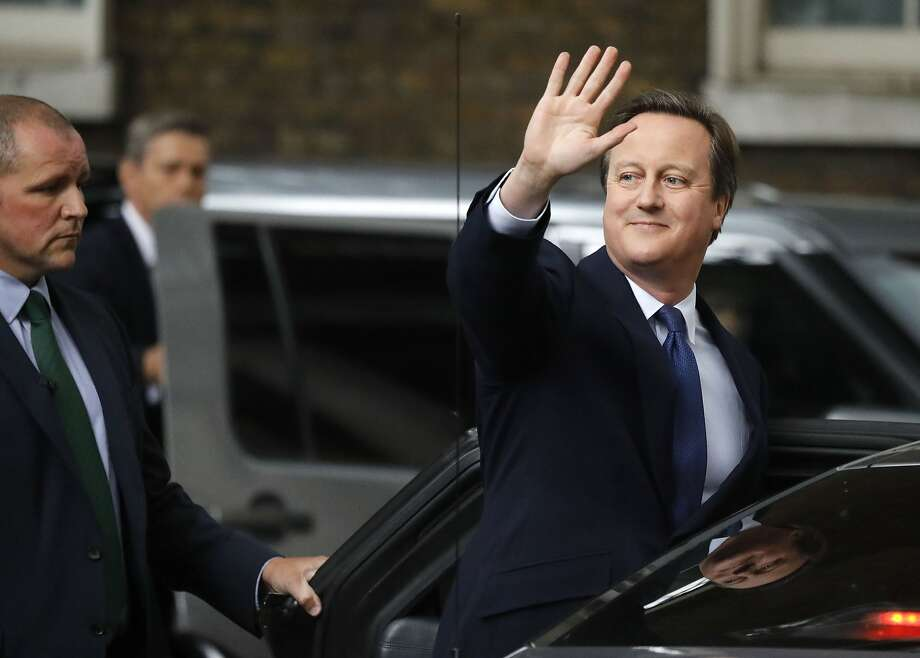 Britain's Prime Minister David Cameron waves as he leaves 10 Downing Street, in London, Wednesday, July 13, 2016. Cameron will formally resign during a meeting with Queen Elizabeth II at Buckingham Palace, then Theresa May, the Home Secretary, will take over. (AP Photo/Frank Augstein) Photo: Frank Augstein, Associated Press