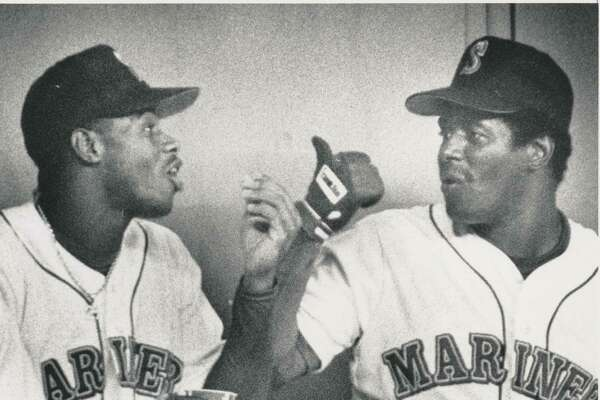 """Original caption dated August 31, 1990: """"Ken Griffey Sr. talking to son Ken Jr. after a play in the outfield where he almost made a sliding catch."""" Seattle P-I Collection image number 2000.107.079.19.06"""