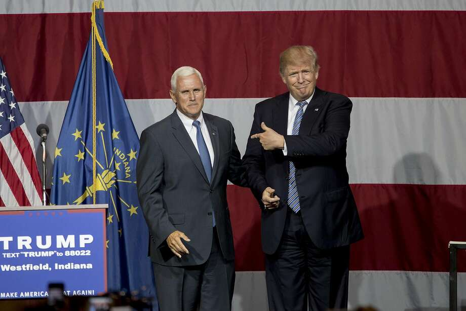 Republican presidential candidate Donald Trump greets Indiana Gov. Mike Pence at the Grand Park Events Center on July 12, 2016 in Westfield, IN. Trump is campaigning amid speculation he may select Indiana Gov. Mike Pence as his running mate. (Photo by Aaron P. Bernstein/Getty Images) Photo: Aaron P. Bernstein, Getty Images