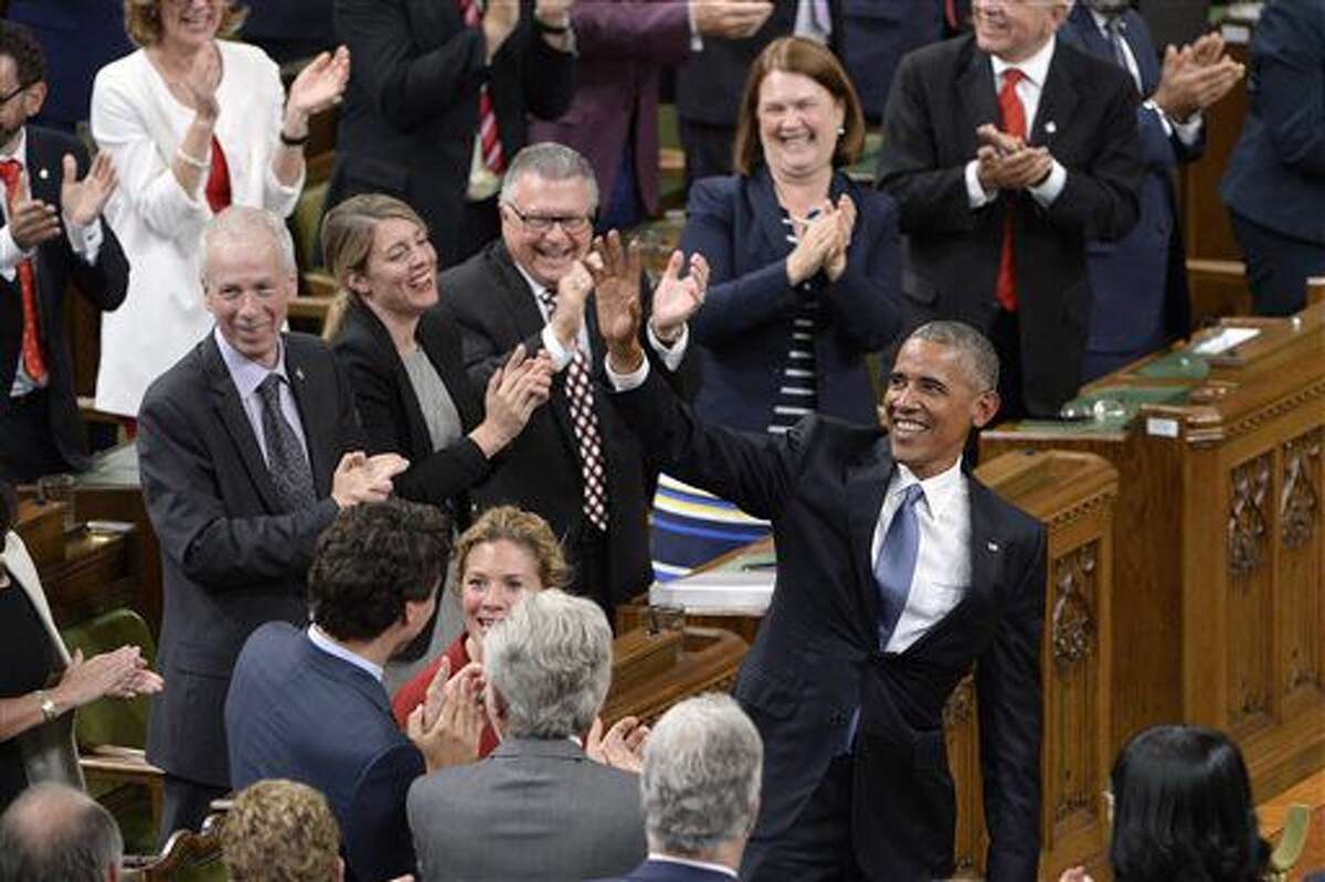 """U.S. President Barack Obama acknowledges people chanting """"Four more years"""" after addressing the Canadian Parliament in the House of Commons in Ottawa on Wednesday, June 29, 2016. (Adrian Wyld/The Canadian Press via AP)"""